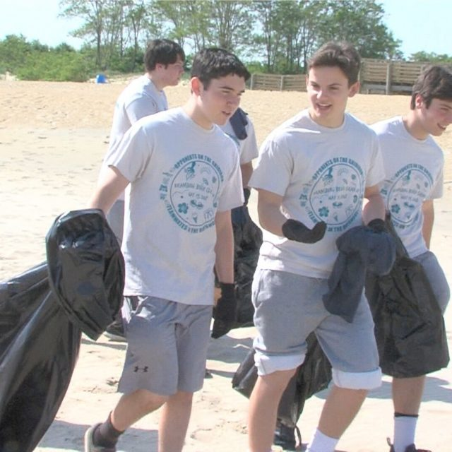 Opponents on the gridiron team up to clean Keansburg beach